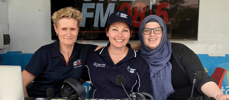 Three female broadcasters at outside broadcast