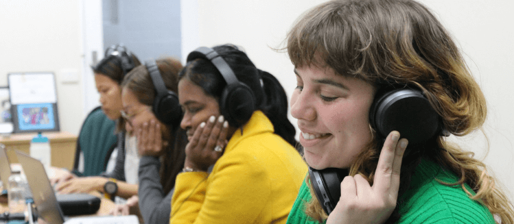 Participants wearing headphones in CMTO training 2019