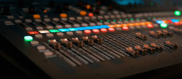 Colour close up of audio mixing deck