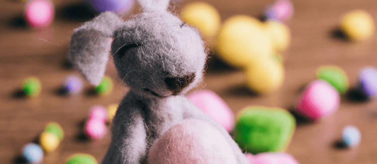 Toy bunny holding an egg
