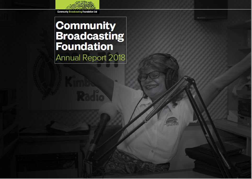 Front cover of publication - Community Broadcasting Foundation. Features woman in studio with arms in air in a celebratory way