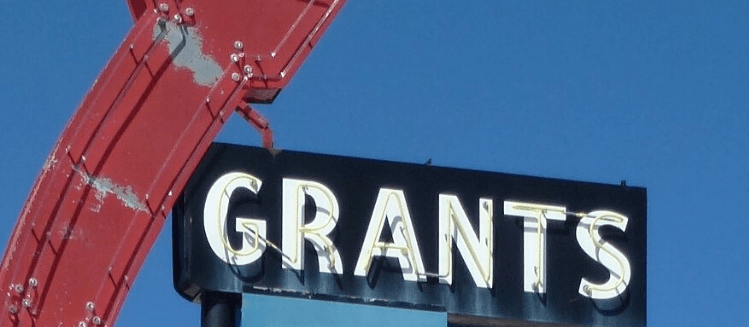 Grants sign against a blue sky