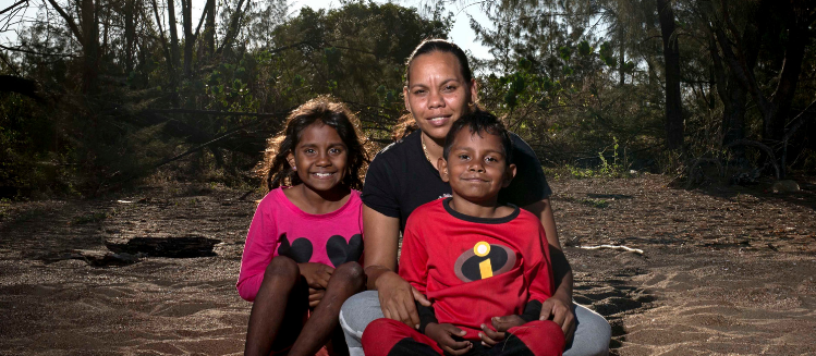 Indigenous woman with two children