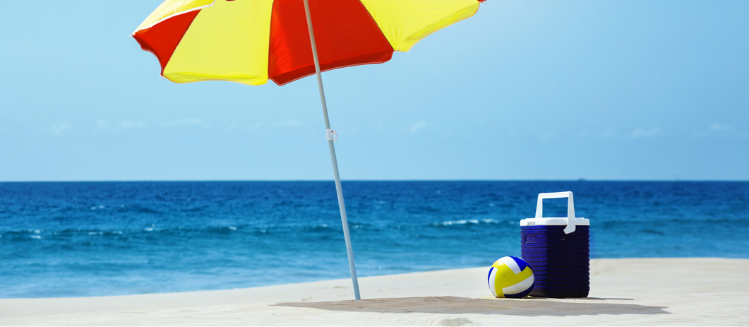 Photo of a beach with a red and yellow umbrella and a blue esky - 2021 Christmas and New year holiday hours