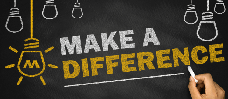 Writing on a chalkboards saying Make a Difference