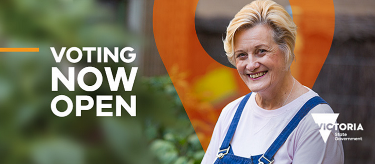 Image of a smiling woman standing outside. Victoria State Government logo with copy 'Voting now open'.