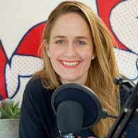Amelia Valen in front of a microphone