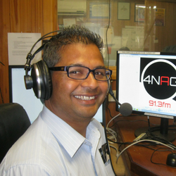 Community radio broadcaster Suraj from 4NAG in studio broadcasting in Nepalese.