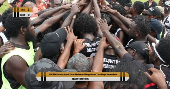 The quarter time huddle at the Tiwi Islands Grand Final - photo credit: ICTV