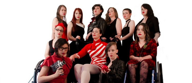 The cast of the F Word dressed in various outfits of red, white and black. Gathered together as a group with some sitting and others standing - looking seriously at camera.