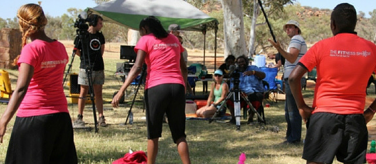 Crew of The Fitness Show filming outdoors.