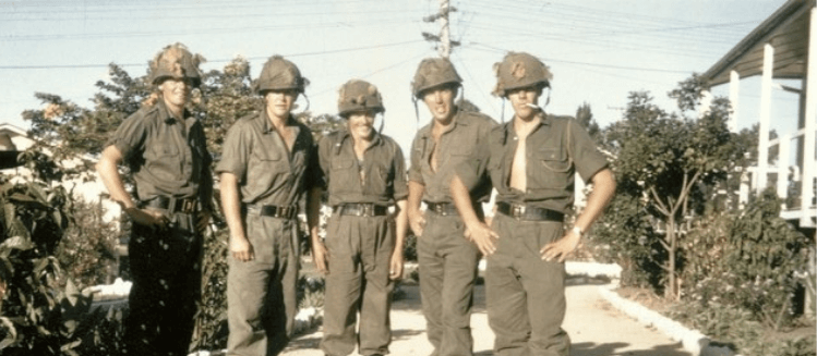 Four Australian men in war uniforms in 1966